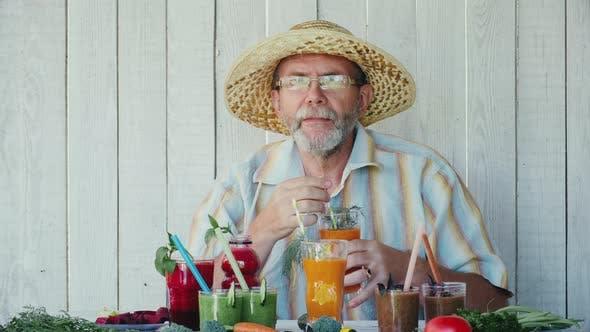 Thumbnail for Senior man tastes various smoothies