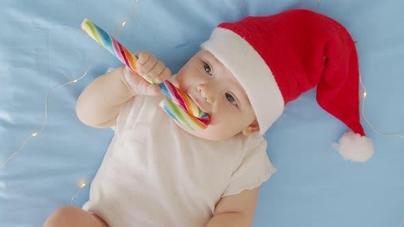 Thumbnail for Portrait of Adorable Infant Baby Girl Wearing Santa Hat. Christmas Celebration Concept