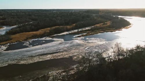 Orbit Shot River Gauja with Melting Snow and Ice in Spring Aerial