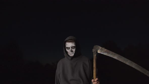 Thumbnail for Scary Death Reaper with Scythe Creeping at Dusk