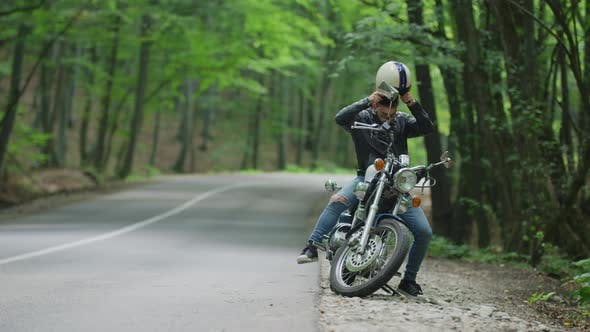 Thumbnail for Man gets on motorcycle and rides away