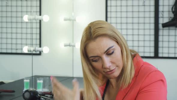Thumbnail for Mature Woman Looking Upset Examining Her Hair with Split Ends