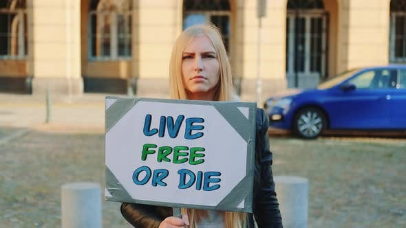 Thumbnail for Woman with Protest Banner Calling To Live Free or Die
