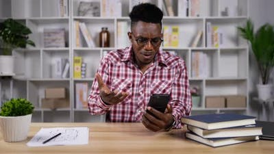 Young African man upset on app crashed in smartphone