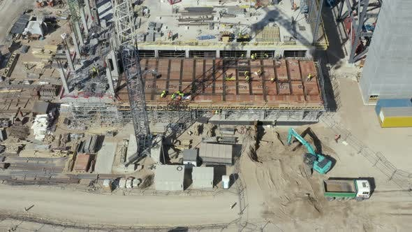 Cover Image for Construction Site with Crowd of Builders and Building Machinery