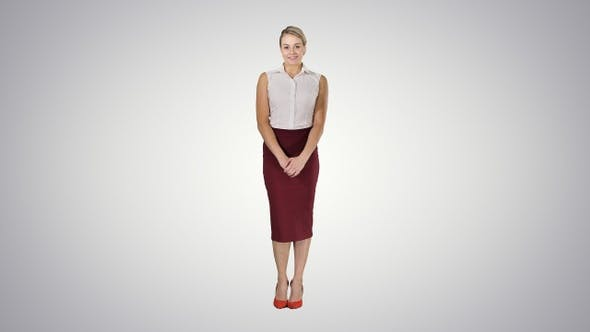 Thumbnail for Attractive shy businesswoman standing and looking to the
