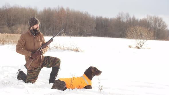 Thumbnail for Awesome Young Man with His Dog During the Hunting