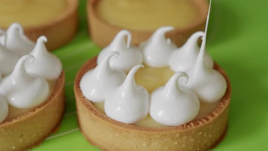 Thumbnail for Pastry Chef Decorates Biscuit Tartlet with Cream From Pastry Bag, Close-up. V5