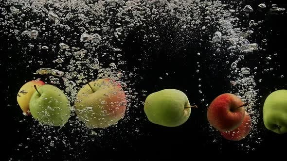 Thumbnail for Fresh Apples Green and Red Falling Into Water with Air Bubbles Isolated on Black Background