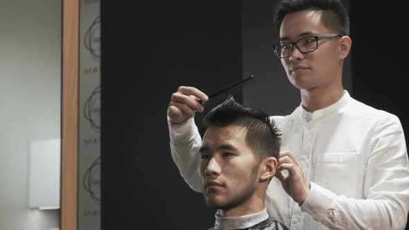 Thumbnail for Hairdresser Combing Client Hair in Salon.