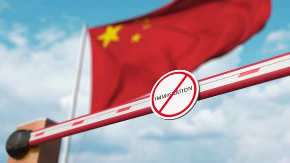 Opening Barrier with No Immigration Sign at the Chinese Flag