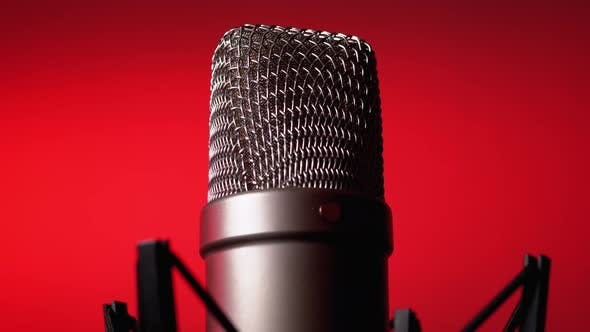 Thumbnail for Studio Condenser Microphone Rotates on Red Background