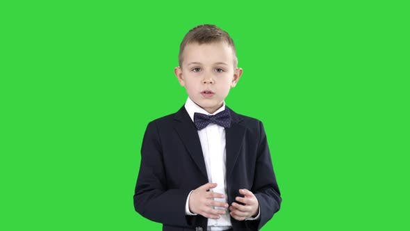 Thumbnail for Serious Little Boy Giving a Speech To Camera on a Green Screen, Chroma Key.
