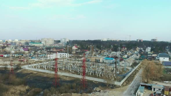 Hydroelectric power station. Electric substation with tall pylons and hog voltage distribution cable