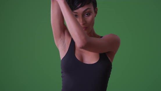 Medium of a millennial african American woman sexually dancing on green screen