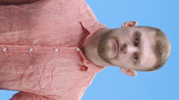 Thumbnail for Young Man Silencing Himself