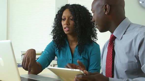 Thumbnail for African American business colleagues using laptop and tablet computers