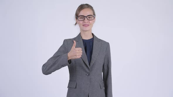 Thumbnail for Young Happy Businesswoman Giving Thumbs Up