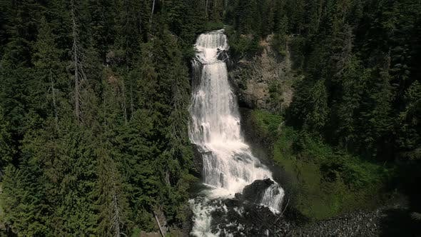 Thumbnail for Aerial Dolly Of Multi Tier Waterfall In British Columbia Wilderness