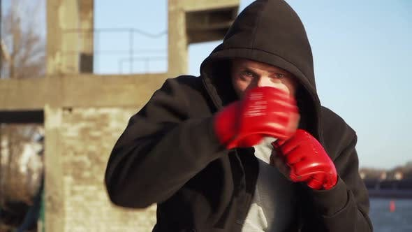 Thumbnail for Boy Boxer Red Boxing Gloves Training Outdoors