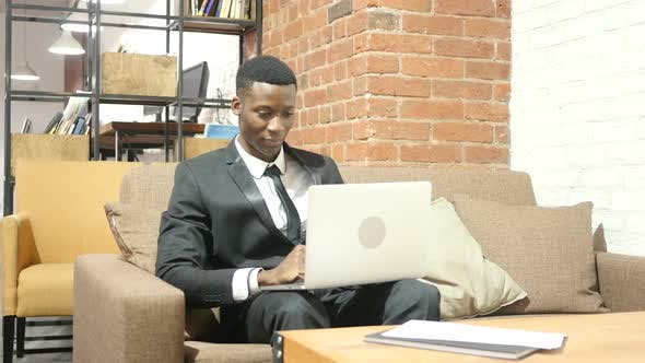 Thumbnail for Black Businessman Cheering Success, Working on Laptop