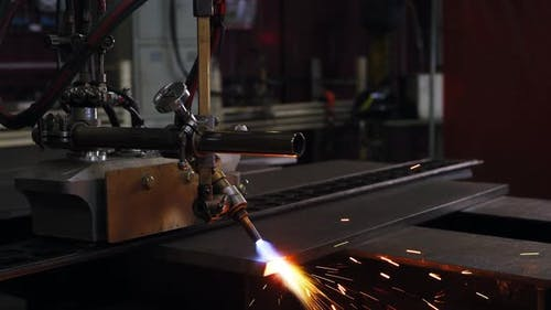 A Welding Machine is Processing the Edge of a Metal Sheet