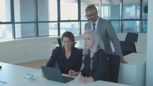 Group of Businesspeople Using Laptop for Video Talk
