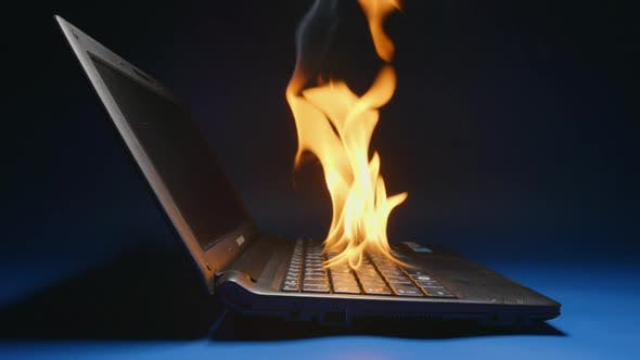 Thumbnail for Laptop flaming on a table