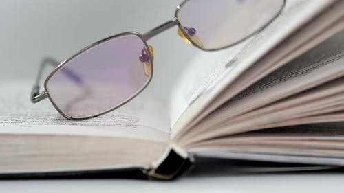 Closeup of Open Book on the Floor Selective Focus and Shallow Depth of Field