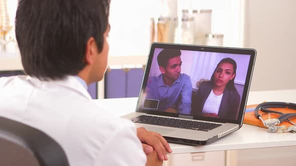 Thumbnail for Mexican couple talking to their doctor via webcam