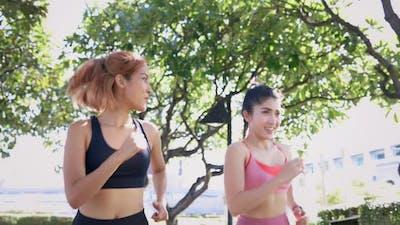 Female Friends Running in Park
