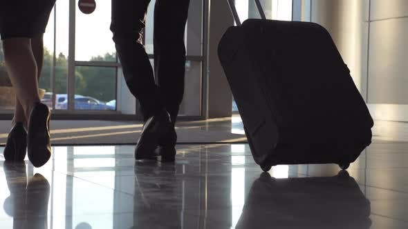 Thumbnail for Business People Leaving Airport Through Automatic Glass Door with Their Luggage. Young Man and Woman