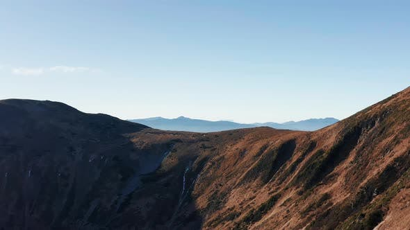 Thumbnail for Mountain landscape with hills, peaks and morning fog in the valley. Aerial view.