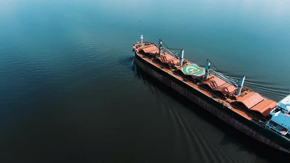 Thumbnail for Pictorial Brown Cargo Ship Sails on Endless Blue Ocean