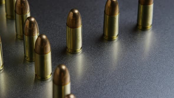 Cinematic rotating shot of bullets on a metallic surface - BULLETS 037