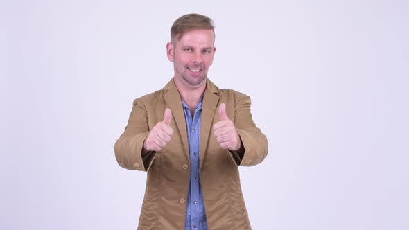 Cover Image for Happy Blonde Casual Businessman Giving Thumbs Up