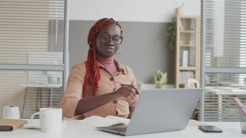 African Female Manager Working on Computer