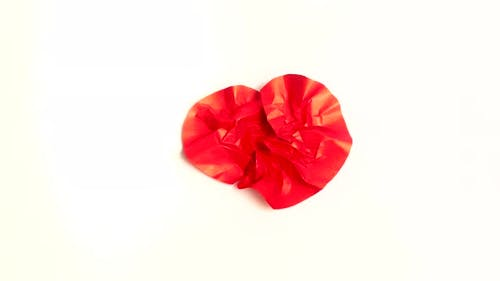 Red Paper Heart Beat on white background Crumple and Uncrumple Stop Motion Animation