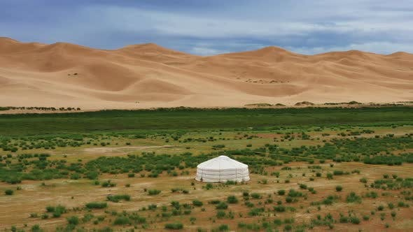 Thumbnail for Aerial Around View on Yurt Near Sand Dunes