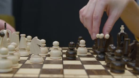 Two Players Make Their Moves in Chess Game Closeup
