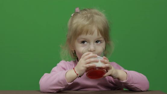Thumbnail for Girl Sitting at the Table and Drinks Yogurt Milk. Funny Milk Mustache