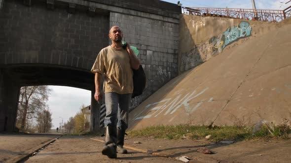 Thumbnail for Homeless Mature Man Walking Near Bridge