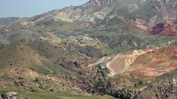 Thumbnail for Colorful Mine Lode on Soil Surface in Mountains