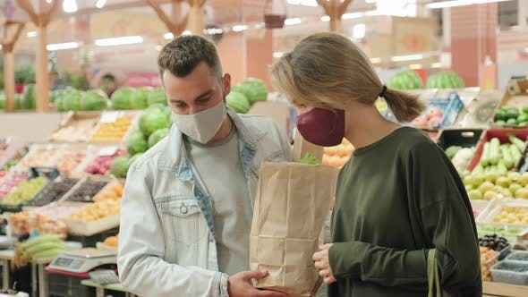 Thumbnail for Couple Shopping for Fruit at Market during Pandemic