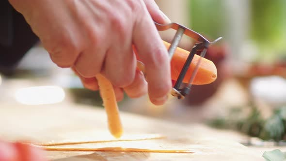 Thumbnail for Close Up Shot of Peeling Fresh Carrot with Vegetable Peeler
