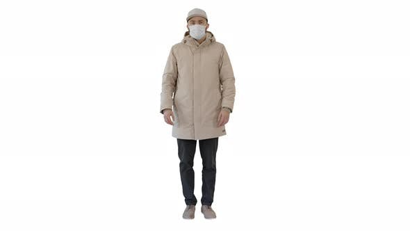 Thumbnail for Young Man in Flu Mask Standing Doing Nothing on White Background
