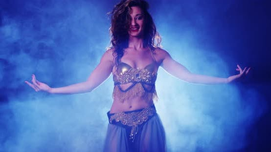 Thumbnail for Young woman belly dancer dancing in studio