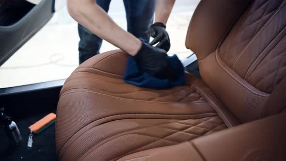Thumbnail for Wiping and Processing Leather Seats of the Car From Dust and Dirt