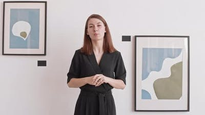 Woman Hosting Online Presentation of Exhibition