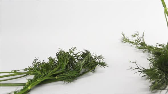 Cover Image for Bunch of Dill Falling Down on White Surface